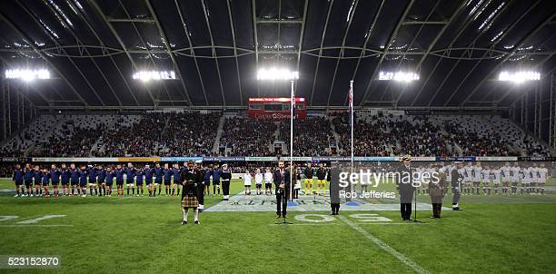 The Highlanders and Sharks stand for a moments silence in remembrance of ANZAC Day during the round nine Super Rugby match between the Highlanders...