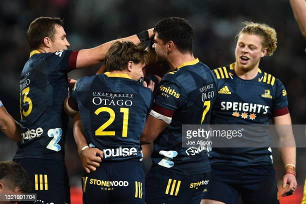 The Highlanders celebrate a try scored by Teariki Ben-Nicholas of the Highlanders during the round four Super Rugby Trans-Tasman match between the...