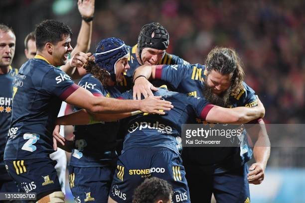 The Highlanders celebrate after Connor Garden-Bachop of the Highlanders dives over to score a try during the round 6 Super Rugby Aotearoa match...
