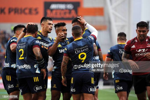 The Highlanders celebrate after Shannon Frizell's try during the round one Super Rugby Aotearoa match between the Highlanders and the Crusaders at...