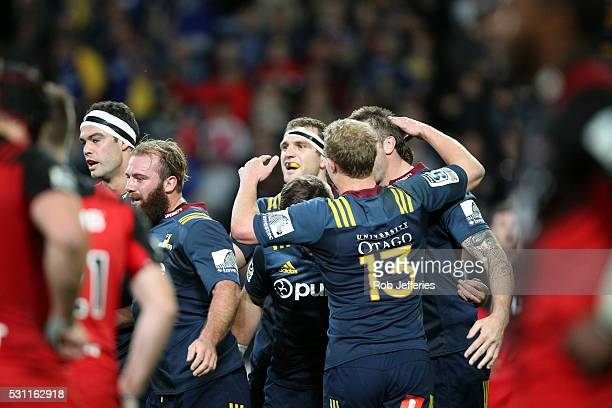 The Highlanders celebrate Liam Squires try during the round twelve Super Rugby match between the Highlanders and Crusaders at Forsyth Barr Stadium...