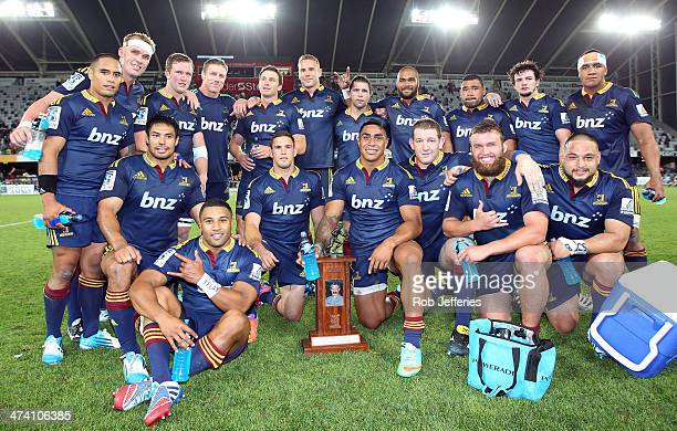 The Highlanders pose for a photo with the Gordon Hunter Memorial Trophy after the Highlanders win during the round two Super Rugby match between the...