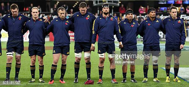 The Highlanders stand for a moments silence in remembrance of ANZAC Day during the round nine Super Rugby match between the Highlanders and the...