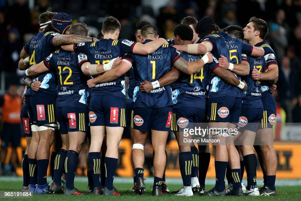 The Highlanders take a minute of silence in respect for the loss of coach Aaron Maugers mother Christine Wilson ahead of the round 16 Super Rugby...