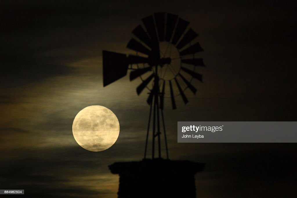 The Highlands Ranch iconic windmill is illuminated by the first (and last) 'supermoon' of 2017 on December 3, 2017 in Highlands Ranch, Colorado. Supermoons happen when a full moon approximately coincides with the moon's perigee, or a point in its orbit at which it is closest to Earth. This makes the moon appear up to 14 percent larger and 30 percent brighter than usual.
