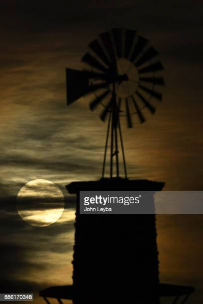 The Highlands Ranch iconic windmill is illuminated by the first 'supermoon' of 2017 on December 3 2017 in Highlands Ranch Colorado Supermoons happen...