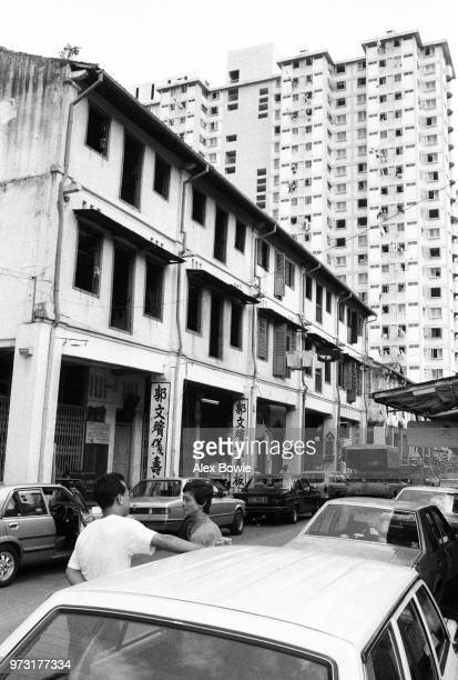 The highrise Kreta Ayer Complex looms above shophouses on Sago Lane Chinatown Singapore 12 July 1983 Today this is the site of a carpark and the...