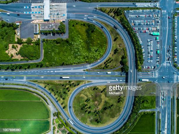 the highway is surrounded by nature. - asia pac stock pictures, royalty-free photos & images