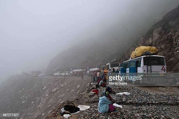 CONTENT] the highway on the mountains on the way from batal to rohtang was blocked due to lanslide repairs its the common sight wherein people wait...