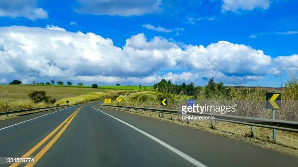 the highway under blue sky with white clouds. - crmacedonio stock pictures, royalty-free photos & images