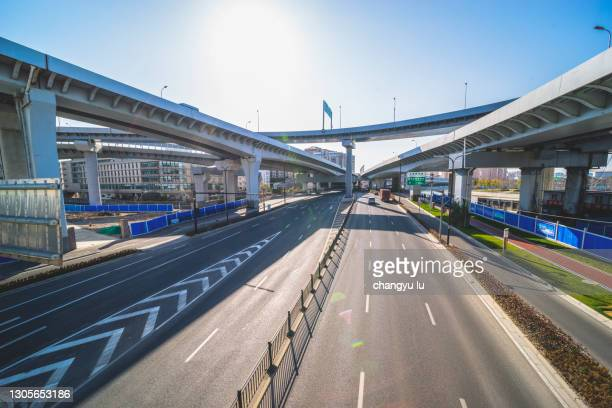 the highway under the viaduct - major stock pictures, royalty-free photos & images