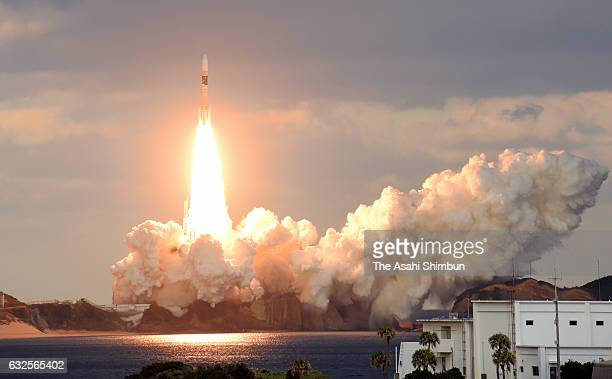 The HIIA 32 rocket carrying the Xband communication satellite lifts off from the Japan Aerospace Exploration Agency 's Tanegashima Space Center on...