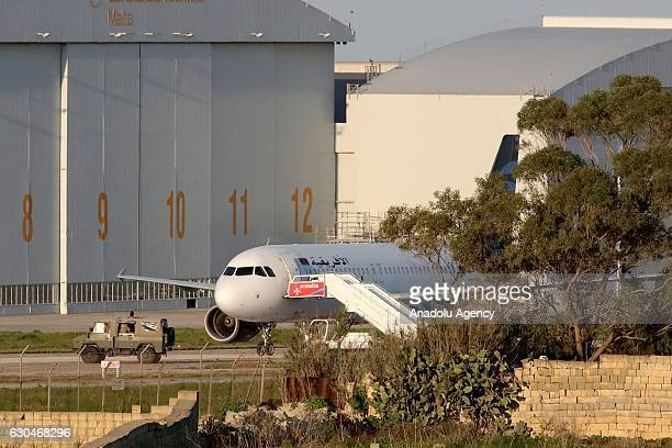 The hijacked Afriqiyah Airways A320 lies on part of the runway of the Malta International Airport Luqa Malta 23 December 2016