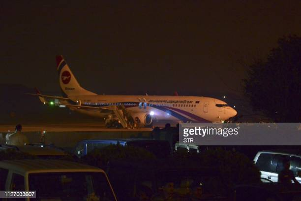 The hijacked Dubaibound Bangladesh Biman plane is seen at the tarmac after an emergency landing at the Shah Amanat International Airport in...