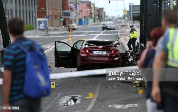 The hijacked taxi which crashed into a lock bridge on North Wall Quay in Dublin city centre early this morning killing a man in his twenties
