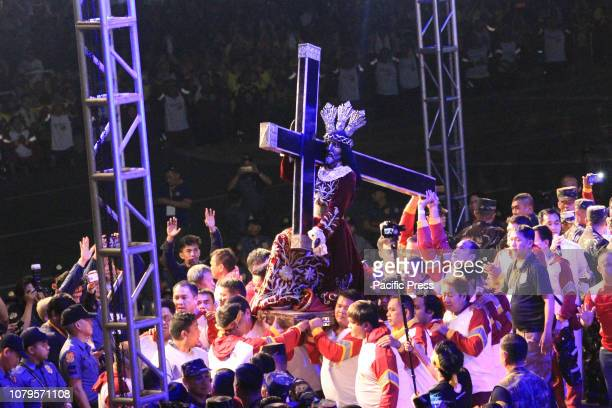GRANDSTAND MANILA NCR PHILIPPINES The Hijos de Nazareno carry the Icon of the Black Nazarene from its platfrom at the Stage of Quirino Grandstand to...