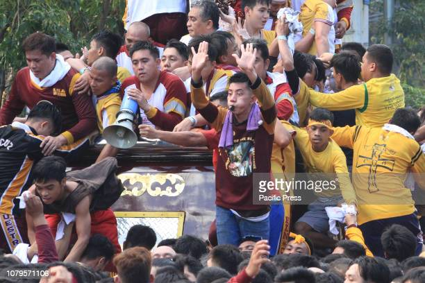 AVENUE MANILA NCR PHILIPPINES The hijos de Nazarenos direct the devotess as to which direction to pull the ropes or push the carriage as the...
