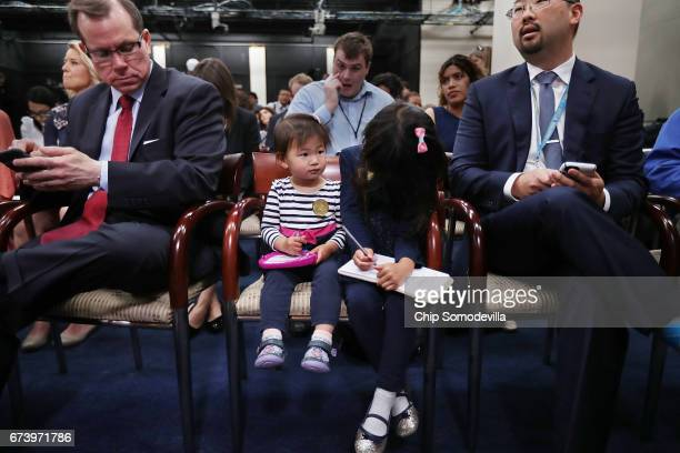 The Hill reporter Scott Wong sits with his daughters Olivia and Abby during a news conference with Speaker of the House Paul Ryan at the US Capitol...