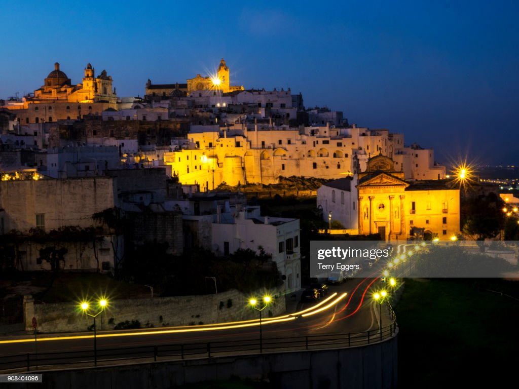 The hill town of Ostuni in Apulia, southern Italy, at night with the Basilica Cathedral illuminated : Stock Photo