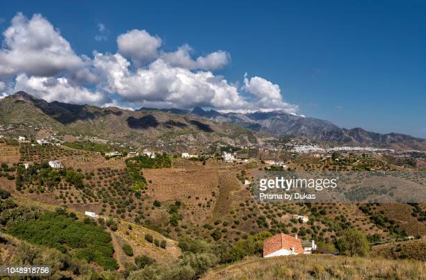 The hills of nature park Sierras de Tejeda and a white village, Frigiliana, Spain.