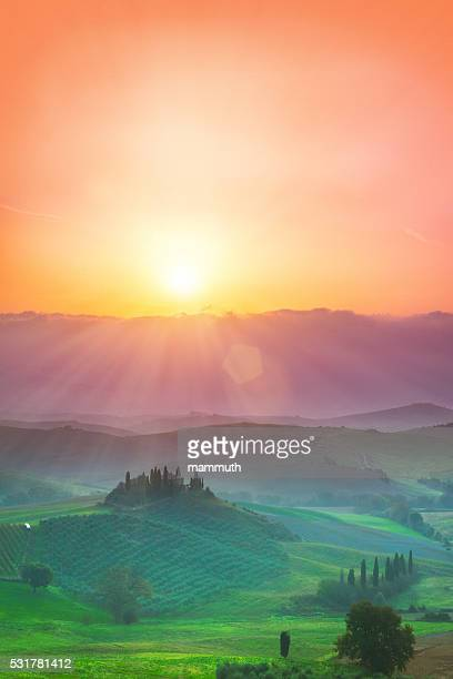 The hills of Val d'Orcia in Tuscany, Italy at sunrise.