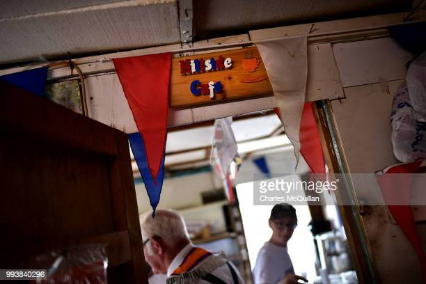 The 'Hillside Cafe' sign is seen as Orangemen take part in the Drumcree march and protest on July 8, 2018 in Portadown, Northern Ireland. The...