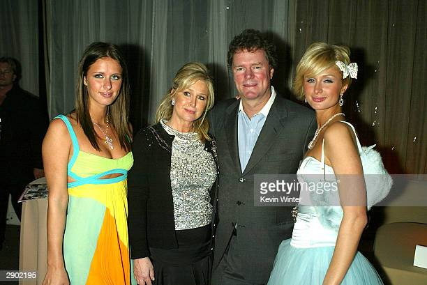 The Hiltons Nicky Kathy Rick and Paris pose at the Miramax Golden Globes AfterParty at Trader Vics on January 25 2004 in Beverly Hills California