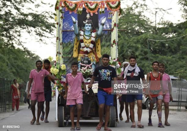 The Hindu devotees Kanwariyas carrying Ganga water return Noida after walking from Haridwar on July 19 2017 in Noida India