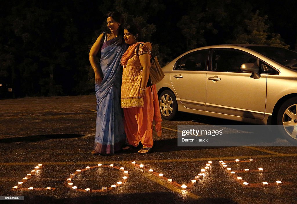 The Hindu Temple of Wisconsin holds a vigil for the Sikh community along with mourners on August, 9 2012 in Pewaukee, Wisconsin. Suspected gunman, 40-year-old Wade Michael Page, allegedly killed six people at the temple on August 5 and then killed himself at the scene. He was an army veteran and reportedly a former member of a white supremacist heavy metal band. Three others were critically wounded in the attack.