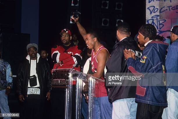 The hip hop group 'A Tribe Called Quest' receive an award at the Source Awards in April 1994 in New York