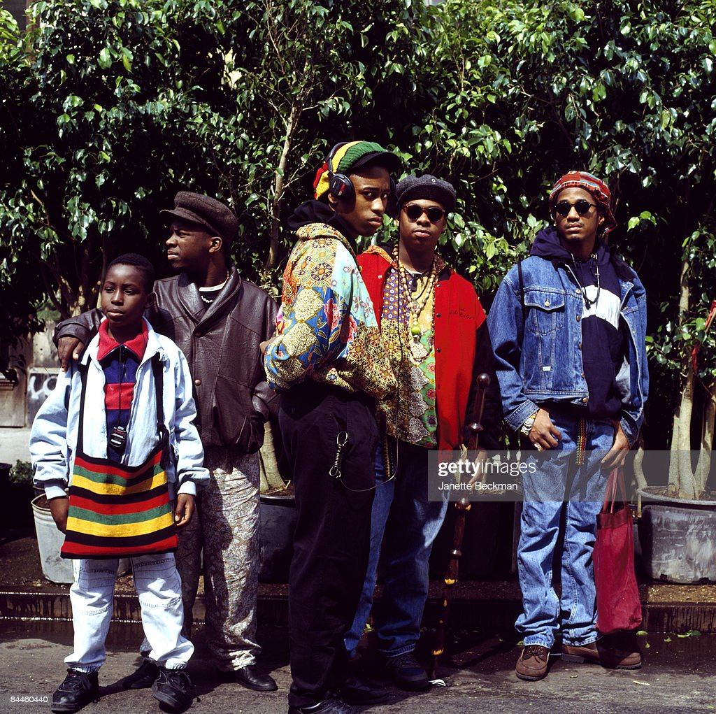 The hiphop group 'A Tribe Called Quest' pose outdoors at an unidentified New York city location, 1990.