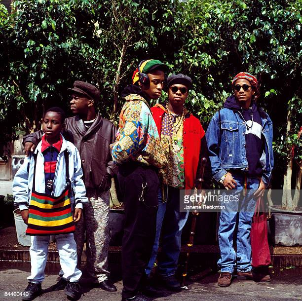The hiphop group 'A Tribe Called Quest' pose outdoors at an unidentified New York city location 1990