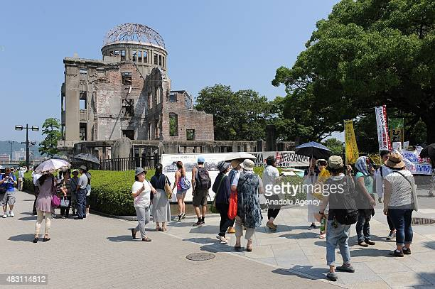 The Hiroshima ABomb Dome is seen as people attend the ceremony at the Peace Center Memory in Hiroshima for the commemoration of the 70th anniversary...