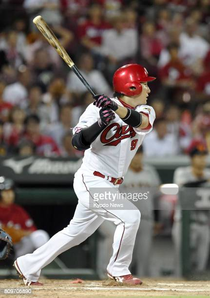 The Hiroshima Carp's Yoshihiro Maru hits a home run during the seventh inning of his team's 65 win over the Yomiuri Giants on July 6 at Mazda Stadium...