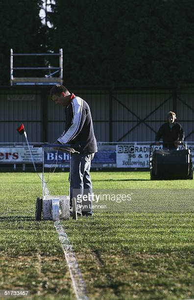 The Histon FC groundstaff prepare the pitch for the FA Cup match between Histon FC and Shrewsbury Town at The Bridge on November 12 2004 in...