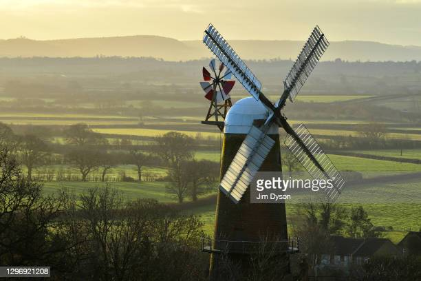 The historic 19th Century Quainton Windmill is pictured at sunrise on January 17, 2021 in Quainton, England.