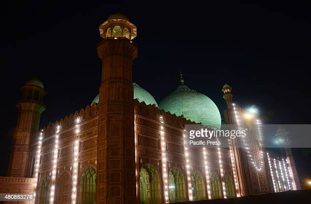 The historic Badshahi Mosque is illuminated with colorful lights to mark the Mahfile Shabeena in Lahore The historic Badshahi Mosque of the Great...