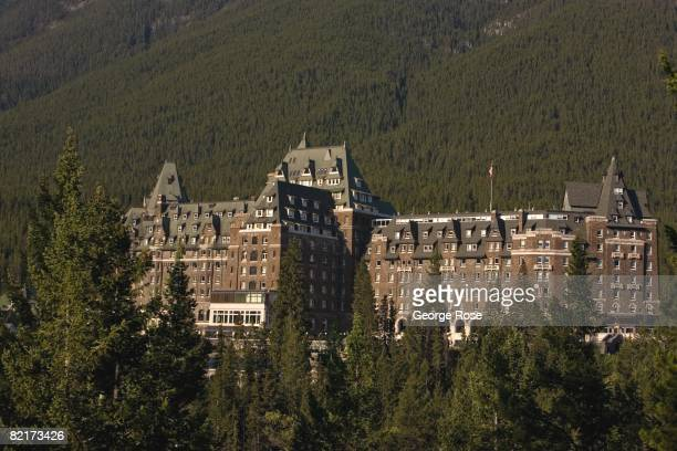 The historic Fairmont Banff Springs Hotel rises above the forest in this 2008 Banff Springs Canada summer sunrise landscape photo