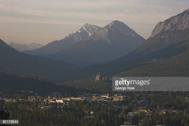 The historic Fairmont Banff Springs Hotel rises above the forest in the distance in this 2008 Banff Springs Canada summer sunrise landscape photo