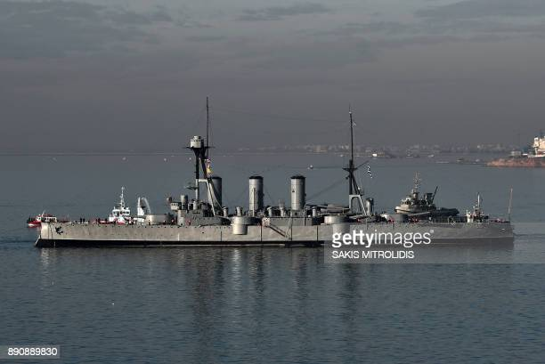 The historic Greek warship Averoff a floating museum leaves the port of Thessaloniki on December 12 2017 The historysteeped Pisaclass armored...