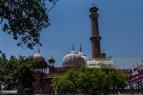 The historic Jama Masjid stands empty during Eid ulFitr the Muslim festival marking the end of the holy fasting month of Ramadan as the country...