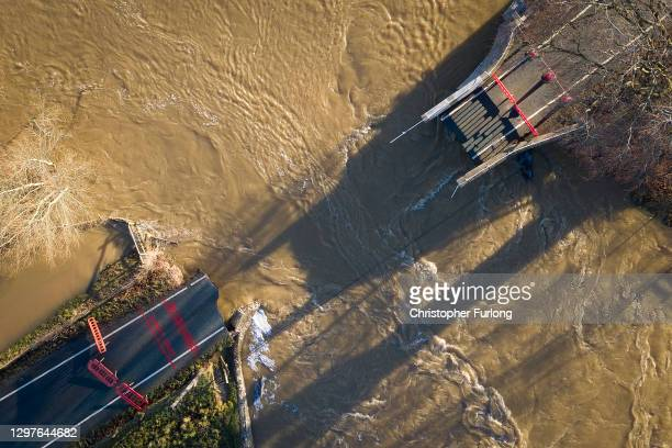 The historic Llanerch Bridge between Trefnant and Tremeirchion which has collapsed due to the floodwaters of Storm Christoph on January 21, 2021 in...