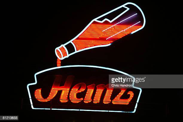 The historic neon Heinz factory sign is seen at night August 23 2004 in Pittsburgh Pennsylvania HJ Heinz Co reported its firstquarter earnings fell 9...