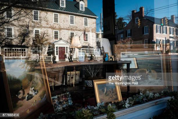 The Historic Red Fox Inn is reflected in the window of The Shaggy Ram antique store on Tuesday November 21 2017 in Middleburg Virginia Middleburg is...