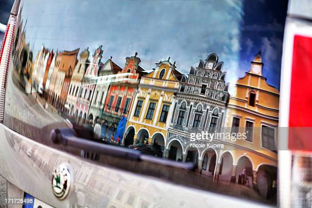 CONTENT] The historic UNESCO World Heritage Site town square buildings of the city Telc in the Czech Republic reflecting in the rear window of a...