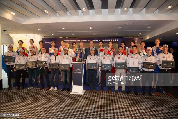 The HKJC's Chief Executive Officer Mr Winfried EngelbrechtBresges and jockeys pose for a group photo PierreCharles Boudot Silvestre de Sousa Leandro...