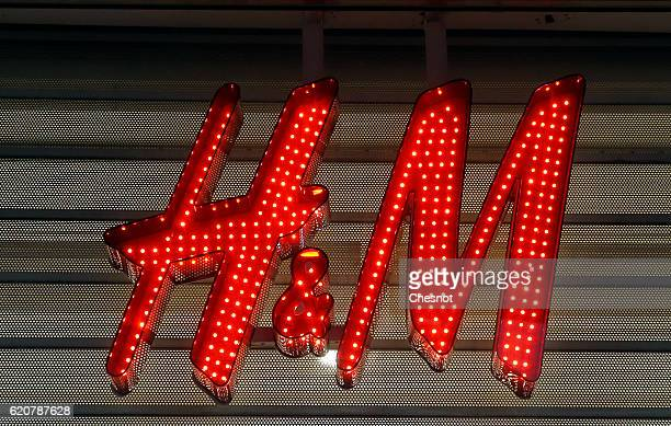 The HM logo is seen during the HM Haussmann store opening at 8 am for the Launch of the Kenzo x HM collection in Paris at HM Boulevard Haussmann on...