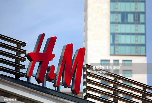 The HM logo sits above a store operated by Hennes Mauritz AB in Berlin Germany on Thursday April 18 2013 Germany's economy is shrugging off a...