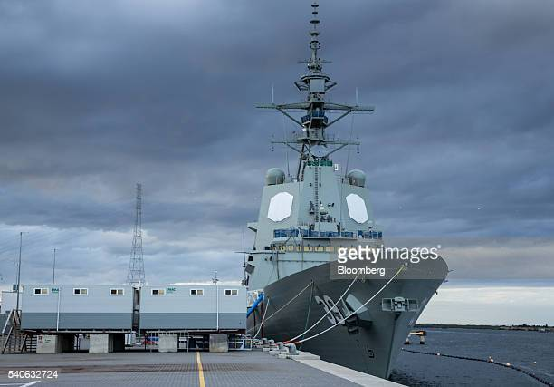 The HMAS Hobart air warfare destroyer stands tied at a dock at the ASC Ltd. Shipyard in Adelaide, Australia, on Monday, May 30, 2016. Right before...