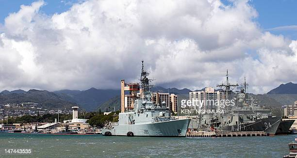 The HMCS Algonquin sits pier side along with the the HMAS Darwin at Joint Base Pearl HarborHickam with the Koolau mountain range as a backdrop for...
